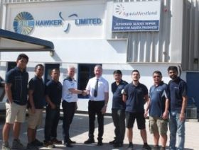 The picture shows RBI Hawker staff with Emlyn Williams (4th left) shaking hands with Mick Warren from Spraytrain.com